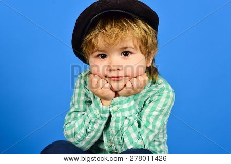 Cute Stylish Boy In Checkered Shirt And Velvet Cap Holds Face On Hands, Closeup Portrait. Fashionabl
