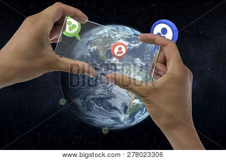 Cropped image of hands holding transparent interface against computer graphic image of earth