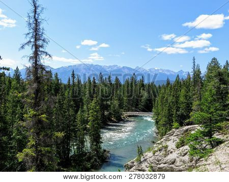 A beautiful view of the Athabasca River, visible from the Maligne Canyon trailhead.  Maligne Canyon is a slot canyon located in the Jasper National Park near Jasper, Alberta, Canada. poster