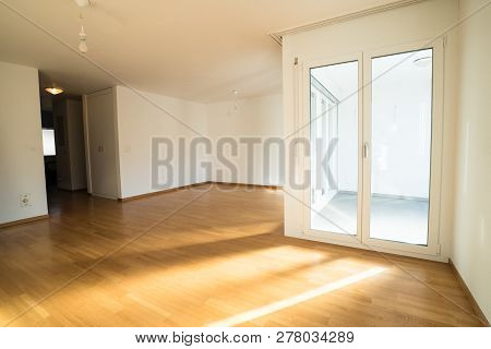 Bright New Living Room In An Empty Apartment With French Doors And Parquet Wooden Floors