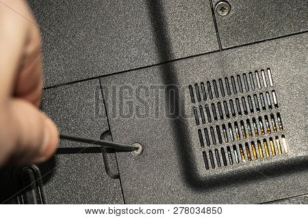 Repairing Old Laptop Pc. Person Repairs Old Pc, Disassembles Its Parts And Does Maintenance.