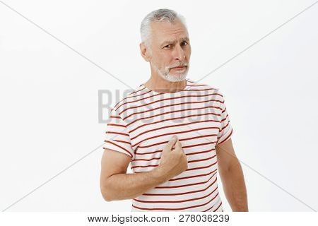 You Talking To Me. Portrait Of Confused And Unsure Good-looking Senior Bearded Male With Grey Hair A