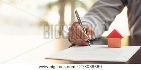 Signing Real Estate Contract In Office Room