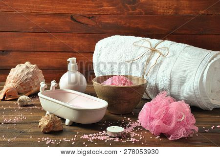 Spa And Body Care Products. Aromatic Rose Bath Dead Sea Salt On The Dark Wooden Background. Natural