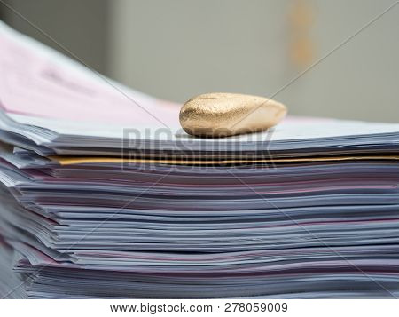 gold nugget luxury paperweight is used to prevent paper blown poster