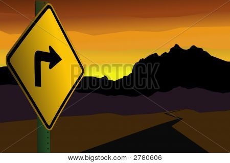 A Yellow Sign Pointing To The Mountains