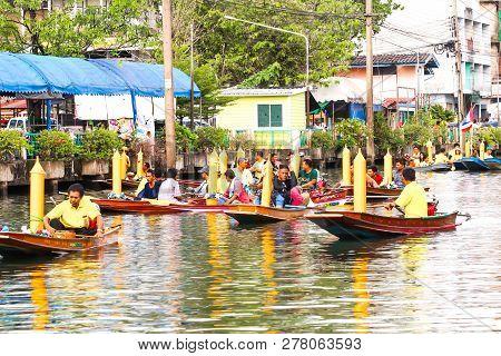Samutsakorn, Thailand - July 27, Parading Of Traditional Candles To Temple At Katumban In Samutsakor