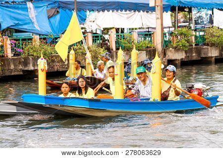 Samutsakorn, Thailand - July 27, Thailand People In Boat Parading Traditional Of Candles To Temple A