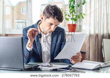 Agent Holding Car Keys And Documents For Registration Of The Car. Concept Of Buying Selling And Rent