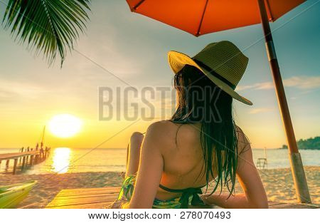 Sexy, Enjoy And Relax Caucasian Woman Wear Bikini Lying And Sunbathing On Sunbed At Sand Beach At Pa