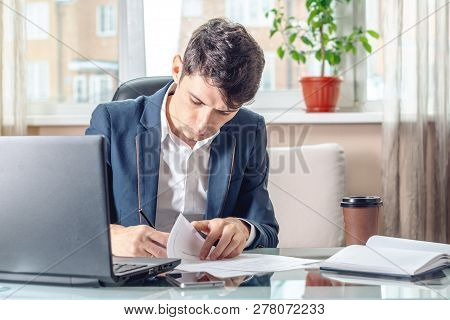 Businessman Sitting At The Table Signing Documents In The Office. Transactions And Work With Securit
