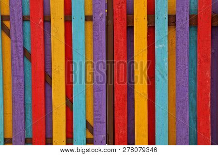 Colored Wooden Texture Of Thin Boards In The Wall Of The Fence
