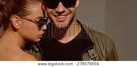 Friendly Relations. Fashion Models In Trendy Sun Glasses. Couple In Love. Couple Of Man And Woman We