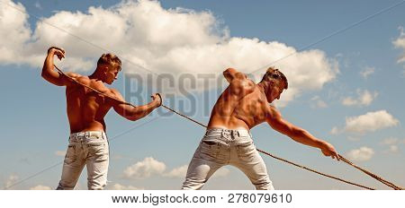 The Meaning Of A Team. Strong Men Pull Ropes. Twins Men Use Muscular Hand Strength. Athletic Twins W