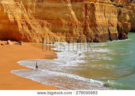 Benagil, Algarve, Portugal - October 31, 2015 : Tourist Walking On Benagil Beach On The Algarve Coas
