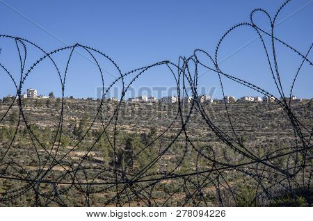 The Palestinian Village Beit Surik Photographed Through A Barbed Wire Fences, Separating It From Isr
