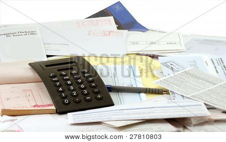 Calculator, legal pad and receipt book and lots of BILLS!