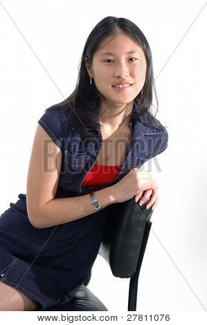 Young Asian woman sitting in a chair