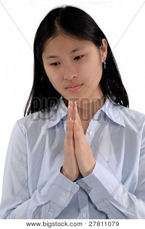 Young Asian woman bows her head in prayer