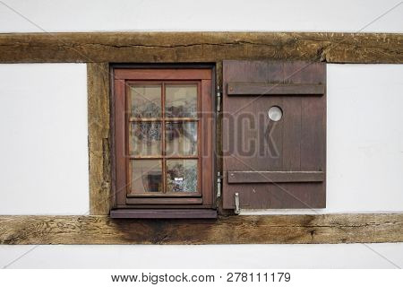 Old Ancient Wooden Window With Blinds Or Shutters. Scenic Original And Colorful View Of Antique Wind
