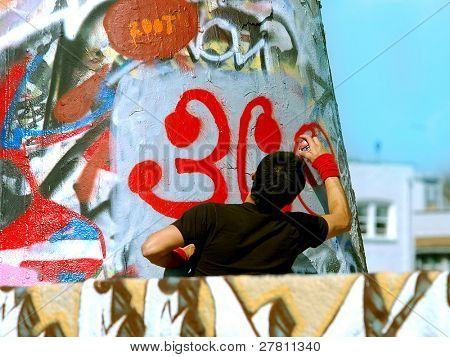 graffiti on a public  wall. It is painted by new taggers daily