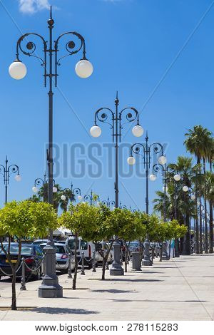 Wrought Lanterns On The Larnaca Seafront, Cyprus. Larnaca City. Modern Street On Blue Cloudy Sky Bac