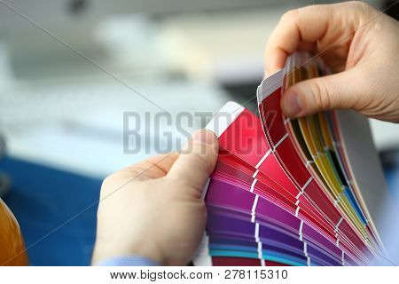 Employee Refueling Cartridge Service Holds Magnifying Glass In Hand. Color Print Of Pantone Statisti