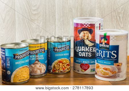 Llano, Tx, Usa - Jan 11; Cans Of Soup And Boxes Of Oats And Grits On Food Bank Shelf