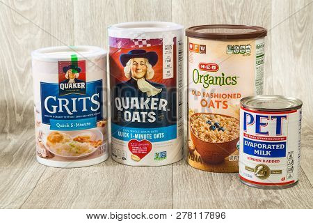 Llano, Tx, Usa - Jan 11; Boxes Of Oats And Grits On Rustic Food Bank Shelf With Evaporated Milk