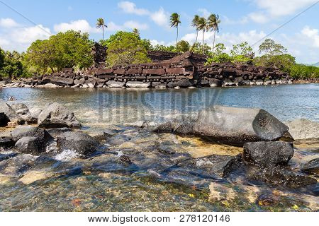 Nan Madol Prehistoric Ruined Stone City Built Of Basalt Slabs, Overgrown With Palms. Ancient Walls B