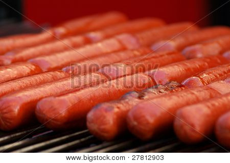 Closeup of Hotdogs on the grill at a County Fair