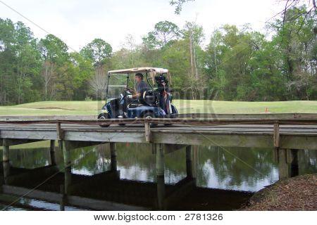 Golfer On Bridge