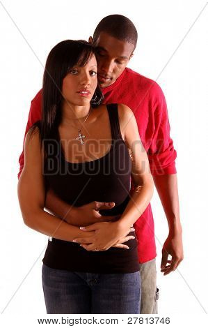 African American couple standing in a casual but tender embrace