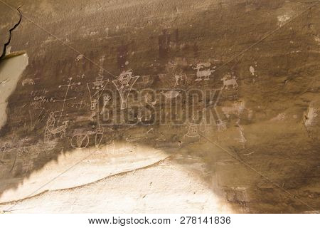 Sego Canyon is a BLM interpretive site in southwest Utah. It houses a ghost town and three distinct styles of rock art from multiple time periods. This is the Fremont rock art panel. poster