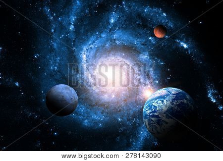 Planets Of The Solar System Against The Background Of A Spiral Galaxy In Space. Elements Of This Ima