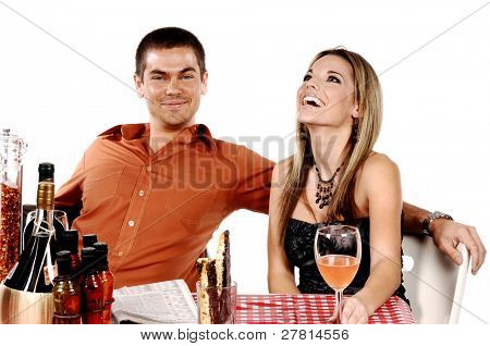 Beautiful and sexywoman and a handsome man enjoying a glass of wine at their favorite Bistro