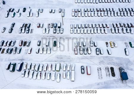 Urban Parking Lot With Parked Cars In The Parking Lot On A Winter Day