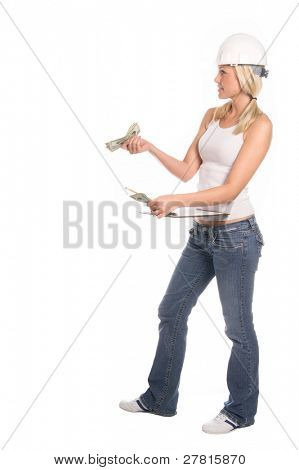 A female construction worker with a handful of cash in cash