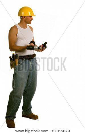 Construction worker in a hard hat and tool belt with a cordless screw gun