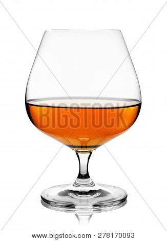 Brandy Or Cognac In Snifter Glass Isolated On White Background With Clipping Path