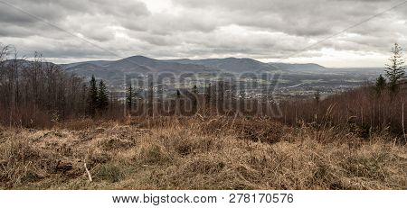 Olse River Valley With Rural Landscape And Moravskoslezske Beskydy Mountain Range On The Background