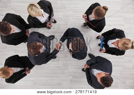 Top View Of A Strong Handshake Between Two Business People , Business Team Support, Effective Negoti