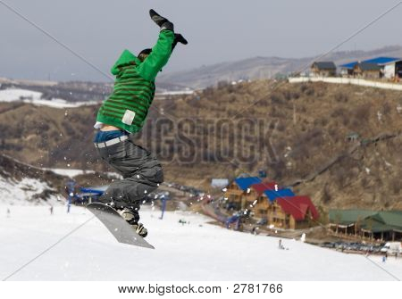 Snowboarder Jumping At Contest In Mountains Tien Shan