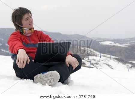 Happy Teens Student With Laptop In Hand In Winter Mountains Tien Shan