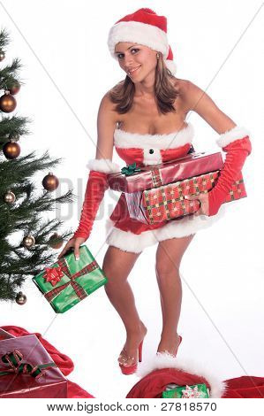Santa's sexy blond helper delivering Christmas Gifts and placing them under the tree