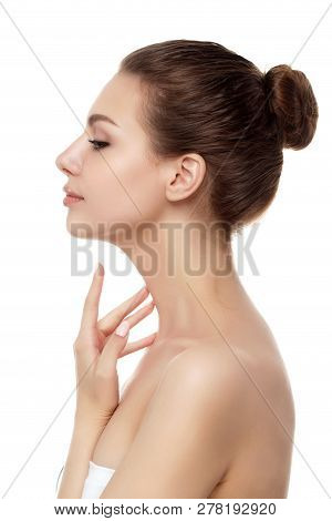 Portrait Of Young Beautiful Caucasian Woman Touching Her Neck Isolated Over White Background. Cleani