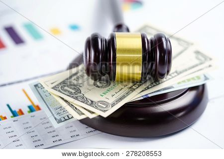 Judge Hammer With Us Dollar Banknotes On Chart Graph Spreadsheet Paper. Financial Development, Banki