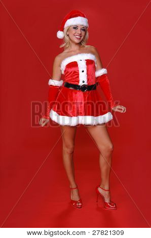 Sexy blond Mrs Santa in a red velvet suit