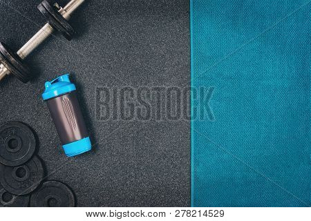 Fitness Or Bodybuilding Background. Dumbbells On Gym Floor, Top View