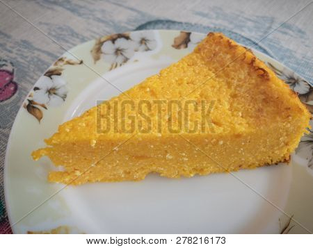 Triangle Piece Of Pumpkin With Cottage Cheese Pie On A Plate